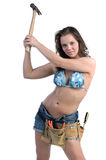 Construction Worker. Cute young woman in Daisy Duke denim shorts, bikini top and a framers tool belt as if she were a construction worker Stock Photography