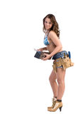 Construction Worker. Cute female construction worker in Daisy Duke denim shorts, bikini top and a framers tool belt with a pan and knife full of drywall mud Stock Image