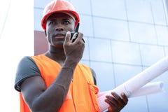 Construction worker. Speaking on Walkie-Talkie Stock Image