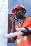 Construction worker. Speaking on Walkie-Talkie Stock Images