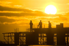 Construction worker. Silhouette of construction worker at sunset Stock Image