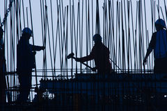 Construction worker. Silhouette of three construction worker Royalty Free Stock Photo