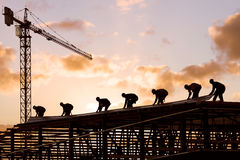 Construction worker. Silhouette of construction worker at sunset Royalty Free Stock Photo