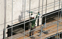 Construction Worker. Building a scaffolding royalty free stock photo