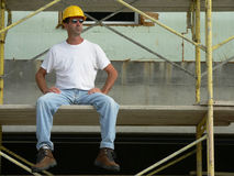 Construction Worker 2. Construction Worker sitting on staging on site royalty free stock photo