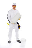 Construction worker. In white overall holding a package of tile adhesive and white bucket on the white background stock images