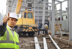 Construction worker. Foreman construction site with construction background and worker Royalty Free Stock Photo