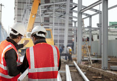 Construction worker. Two foreman discussion on construction site Royalty Free Stock Images