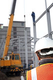 Construction worker. Foreman cheking plant on construction site with worker background and crane machine Stock Photo