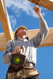 Construction worker. At work with wooden  roof construction Royalty Free Stock Photography