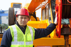 Construction worker. Standing on crane truck stock photos