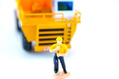 Construction worker. Toy construction worker isolated with a white background Stock Photography