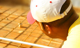 Construction Worker. Closeup of a Construction Worker checking the steel rods Stock Photo