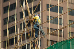 Construction worker. At the bamboo scaffolding in Hong Kong Stock Photography
