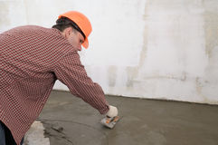 Construction worker. Spreading wet concrete Stock Images