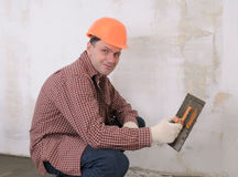 Construction worker. Spreading wet concrete Royalty Free Stock Photos