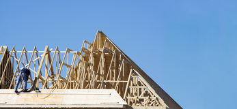 Construction worker. On the roof building a house Stock Image
