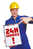 Construction worker advertising 24h. Service on a clipboard royalty free stock photography