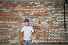 Construction Worker Against Brick Wall Royalty Free Stock Photo