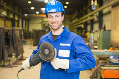 Construction worker with angle grinder Royalty Free Stock Image