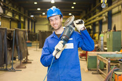 Construction worker with angle grinder Stock Photography