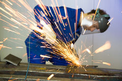 Construction worker with angle grinder Stock Images