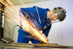 Construction worker with angle grinder Royalty Free Stock Photography