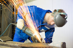 Construction worker with angle grinder Royalty Free Stock Photo