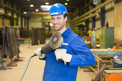 Construction worker with angle grinder Stock Image