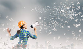 Construction worker announcing something Stock Image