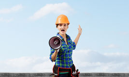 Construction worker announcing something Royalty Free Stock Image