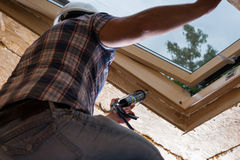 Construction Worker Applying Caulking to Sky Light Royalty Free Stock Image