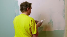 Construction Worker Applying Plaster on a Drywall stock video footage