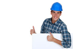 Construction worker approving a board Stock Image