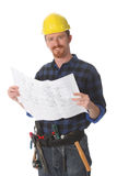 Construction worker with architectural plans stock photography