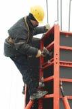 Construction worker assembling Stock Photo