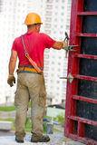Construction worker assembling cement formwork Stock Photo