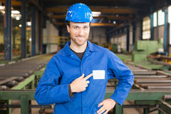 Construction worker in assembly hall Royalty Free Stock Image