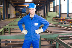 Construction worker in assembly hall Stock Image