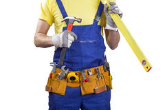 Construction worker with belt and tools in hands on white Stock Image