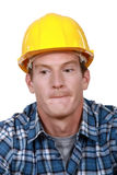 Construction worker biting his lips. Royalty Free Stock Image