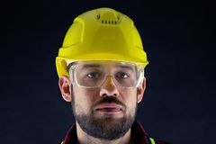 Construction Worker  on black background. stock photography