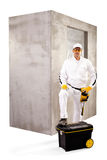 Construction worker with black toolbox and cement wall on white Royalty Free Stock Photos