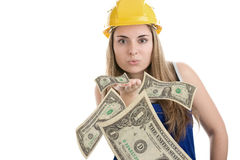 Construction worker blowing money. Construction worker is blowing money on white background Stock Images