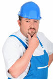 Construction worker in blue overalls Royalty Free Stock Images