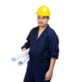 Construction worker and blue print Stock Photo