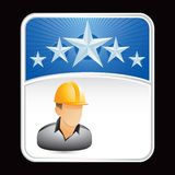 Construction worker on blue star background Royalty Free Stock Photo