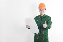 Construction worker with blueprint in one hand and thumb up. Builder with blueprint in one hand and thumb up of the other hand on the white background Stock Images