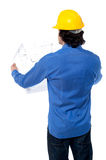 Construction worker with blueprint plan Stock Images