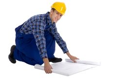 Construction worker with Blueprints. Man wearing a hardhat with plans Royalty Free Stock Photography